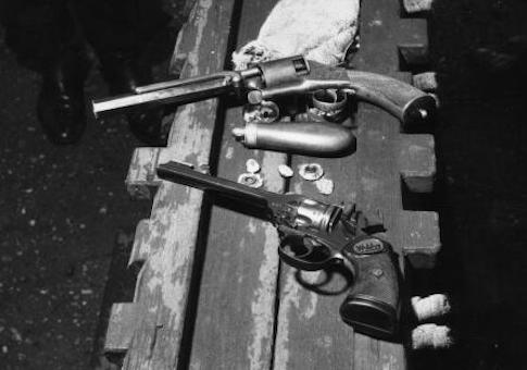 A 1950s Webley .22 revolver and an old muzzleloader