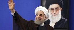 President Hassan Rouhani in front of a portrait of Iran's Supreme Leader Ayatollah Ali Khamenei