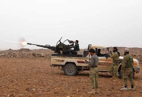 Syrian rebel fighters battle government forces
