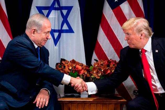 Israel's Prime Minister Benjamin Netanyahu and President Donald Trump shake hands