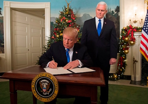 President Donald Trump signs a proclamation after he delivered a statement on Jerusalem as Vice President Mike Pence looks on
