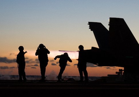 An F/A-18 Hornet takes off from the deck of the USS George H.W. Bush in the Atlantic ocean
