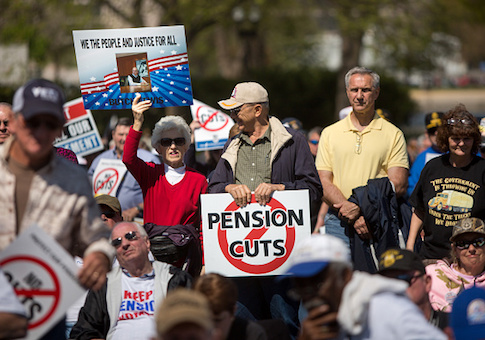 Attendees rally on the West Front of the U.S. Capitol building with Teamsters Union retirees who traveled from across the country to voice their opposition to deep cuts to their pension benefits