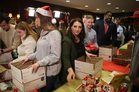 photo image RNC Transforms HQ into 'Santa's Workshop' to Build Care Packages for Military