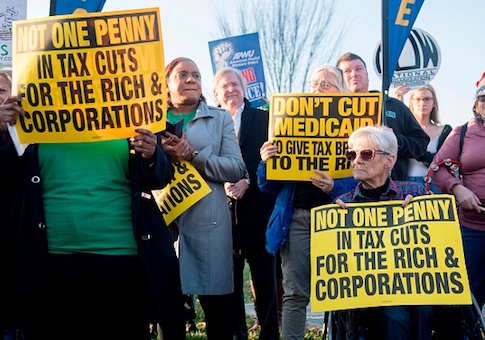 Demonstrators against the Republican tax reform bill hold a protest rally