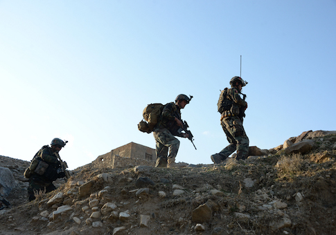 Afghan commandos forces patrol during ongoing US-Afghan military operation against Islamic State militants in Achin district of Nangarhar province