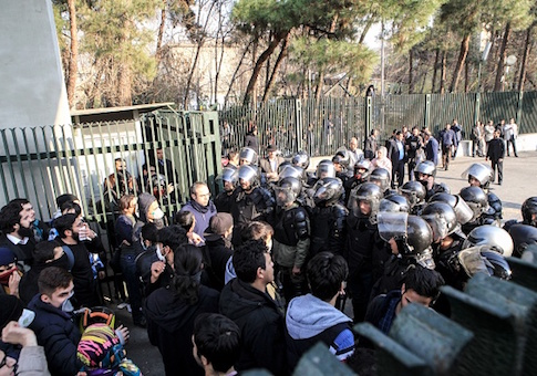 Iranian students scuffle with police at the University of Tehran during a demonstration driven by anger over economic problems