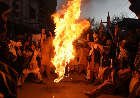 Pakistani demonstrators burn the US flag at a protest in Quetta on January 4