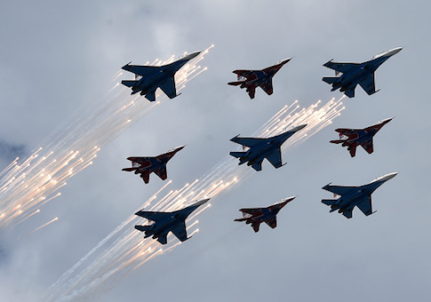 Russian Su-27 jet fighters and MIG 29 jet fighters fly above the Red Square during the Victory Day military parade general rehearsal in Moscow