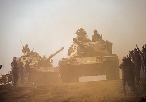 Turkish troops advance near the Syria border at Hassa, Hatay province
