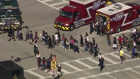 Students are evacuated from Marjory Stoneman Douglas High School during a shooting incident in Parkland, Florida