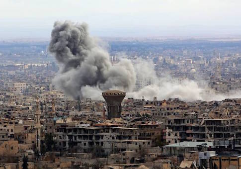 Smoke rises from the rebel-held enclave of Eastern Ghouta on the outskirts of the Syrian capital following fresh air strikes and rocket fire