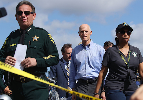 Broward County Sheriff Scott Israel and Florida Governor Rick Scott walk up to the media to speak about the mass shooting at Marjory Stoneman Douglas High School