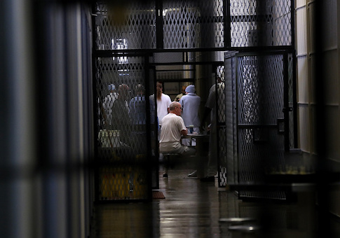 Inmates sits in housing block at San Quentin State Prison