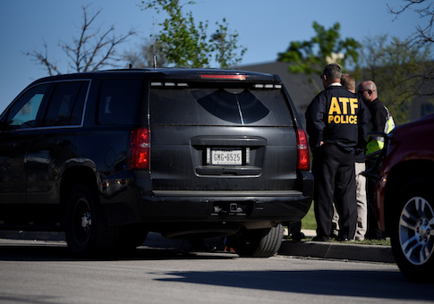 Law enforcement personnel attend the scene of a blast at a FedEx facility in Schertz, Texas
