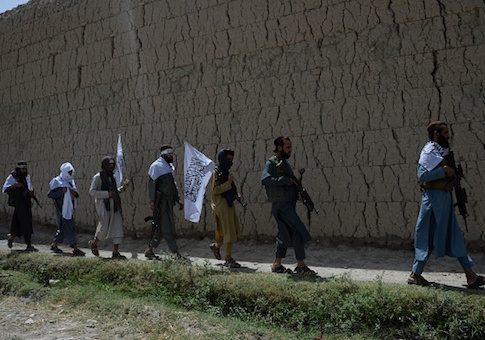 Afghan Taliban militants walk as they took to the street to celebrate ceasefire
