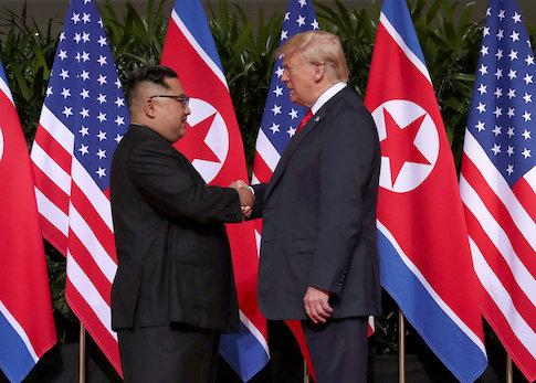 U.S. President Donald Trump shakes hands with North Korean leader Kim Jong Un
