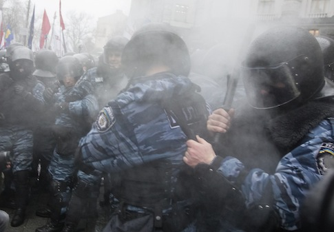 Riot police react after a pepper spray is released into the crowd during a rally in support of EU integration in Kiev