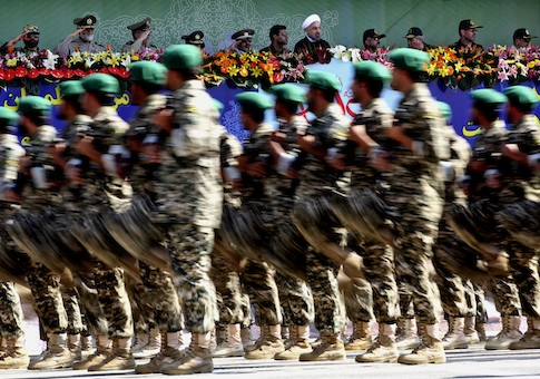 Military forces marching during an annual military parade in Tehran, Iran, Sunday, Sept, 22, 2013