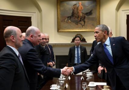 Muslim Brotherhood lobbyist Anas Altikriti standing next to Iraqi Parliament Speaker Usama al-Nujaifi shaking hands with President Obama