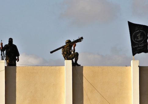 A Palestinian militant from the al-Nasser Brigades, an armed wing of the Popular Resistance Committees (PRC), holds a shoulder missile launcher in Gaza City