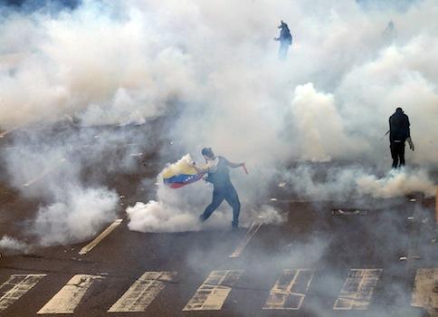 A protestor is teargassed by police in Caracas, Venezuela / AP