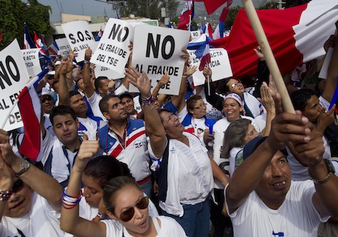 "Supporters of Norman Quijano, Nationalist Republican Alliance presidential candidate, many holding posters that read in Spanish; ""No to electoral fraud,"" demand a vote recount of Sunday's runoff election during a protest"