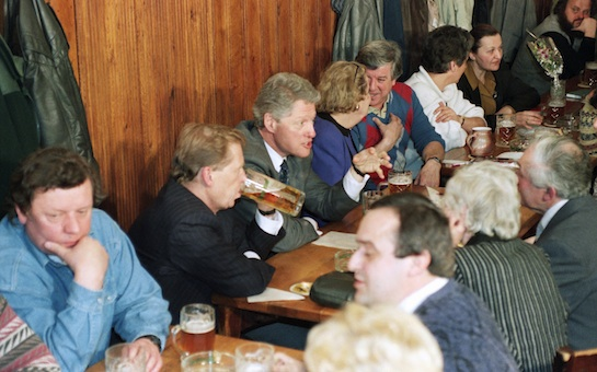U.S. President Bill Clinton talks with guests in the Golden Tiger pub in downtown Prague