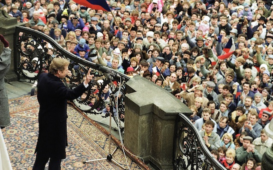 Czech playwright and human rights advocate Vaclav Havel waves to a crowd of several thousands from the balcony of the Prague Castle