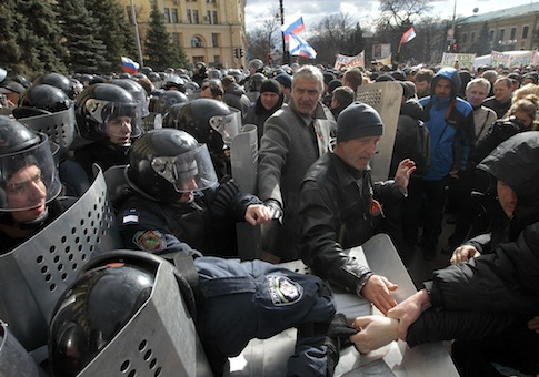 Ukrainian riot police officers tussle with pro-Russia supporters