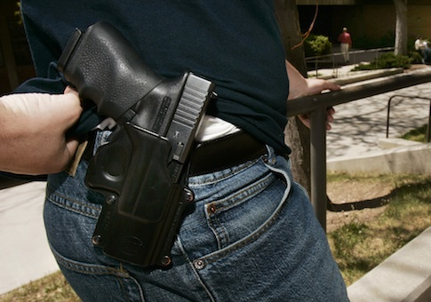 Student displays his Glock 9mm semi-automatic handgun on the University of Utah campus