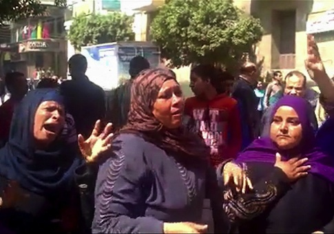 This image made from video shows relatives reacting after an Egyptian court on Monday sentenced to death 529 supporters of ousted Islamist President Mohammed Morsi