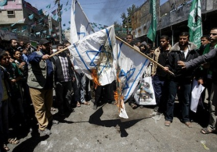 Palestinians burn replicas of the Israeli flag during a rally