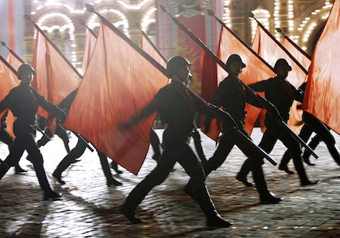 Russian soldiers with Soviet Army Red flags march during a rehearsal for the Victory Day military parade
