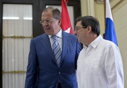 Cuba's Foreign Minister Bruno Rodriguez, right, walks with Russian's Foreign Minister Sergey Lavrov at the Foreign Ministry in Havana, Cuba