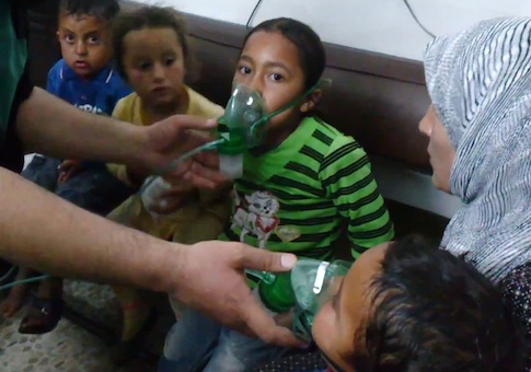 Children receive oxygen in village attacked with poisonous chlorine gas