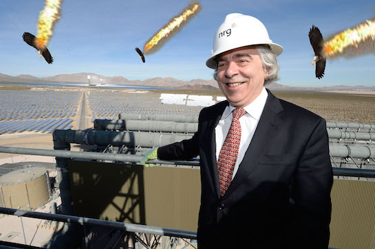 U.S. Secretary of Energy Ernest Moniz gets photobombed by flaming eagles. (AP)