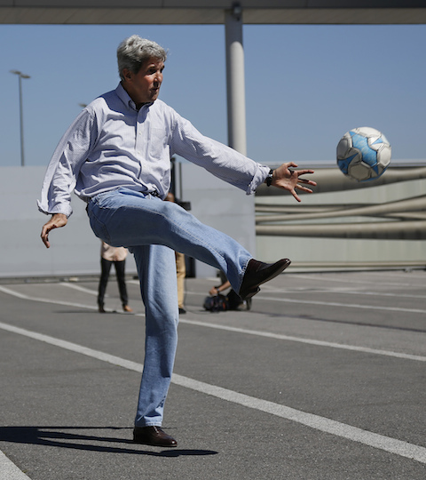 John Kerry performs an un-American act. (AP)