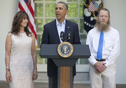 President Barack Obama, accompanied by Jani Bergdahl, left, and Bob Bergdahl, speaks during a news conference in the Rose Garden of the White House in Washington on Saturday