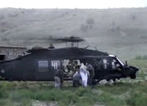 A video screen capture of Bowe Bergdahl being escorted to a helicopter during his handover / AP