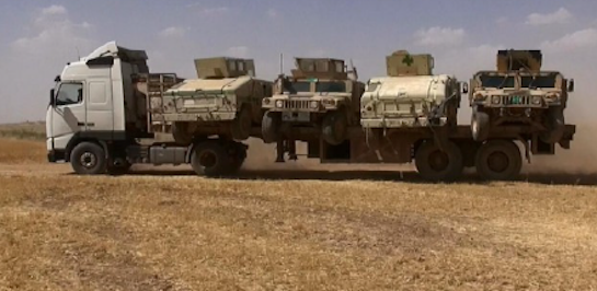 U.S.-made Humvees enroute from Iraq to Syria