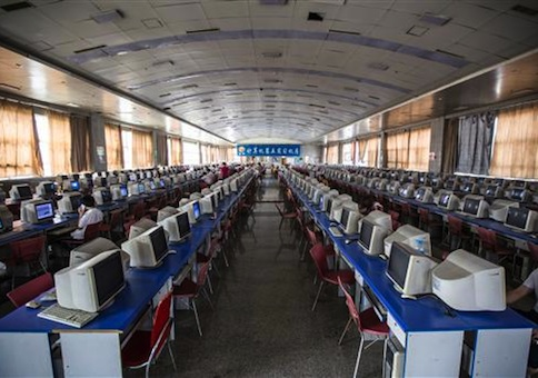 Chinese students learn computer skills in a computer room at Lanxiang Vocational School