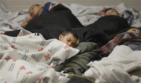 children detainees sleeping in a holding cell at a U.S. Customs and Border Protection processing facility