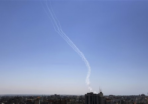 Smoke trails are seen after missiles were fired by Palestinian militants from Gaza City towards southern Israel