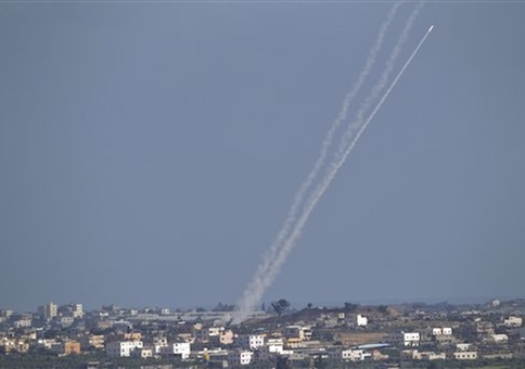 A rocket fired by Palestinian militants from inside Gaza Strip makes its way towards Israel