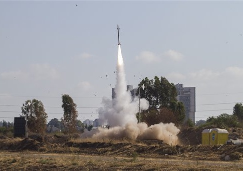 An Iron Dome air defense system fires to intercept a rocket from the Gaza Strip in Tel Aviv