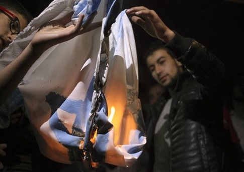 Followers of the Muslim Brotherhood Islamic movement burn a representation of an Israeli flag