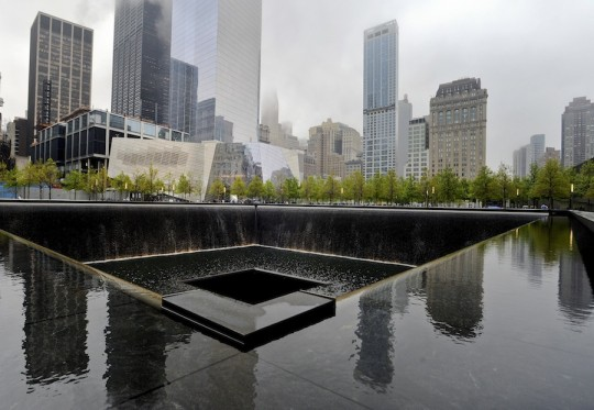 A view of the National September 11 Memorial Museum with the north reflecting pool in foreground