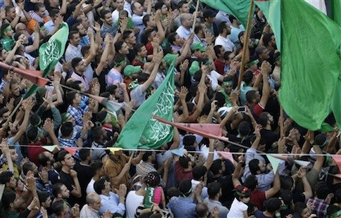Hamas supporters shout slogans against the Israeli military action in Gaza, during a demonstration in the West Bank city of Nablus