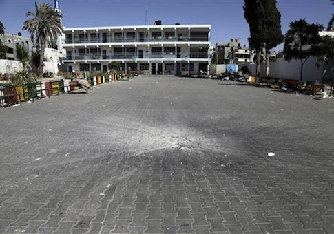 A crater from an Israeli strike is seen in the yard of the U.N. school in Beit Hanoun, in the northern Gaza Strip